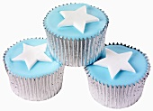 Three cupcakes with blue icing and stars