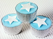 Cupcakes with blue icing and stars