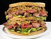 Double-decker roast beef and onion sandwich