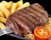 Rump steak with onions and chips