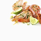 Prawns with lime wedges and herbs