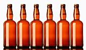 Six unlabelled bottles of beer