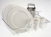 Plates, cups, glasses and grater on dish rack