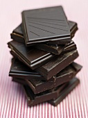 Pieces of organic dark chocolate, stacked