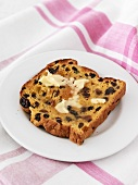Buttered, toasted saffron bread with raisins