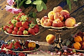 Still life with fresh berries, peaches, apricots, figs