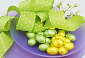 Small chocolate eggs wrapped in foil