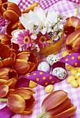 Flower arrangement, sugar eggs, quails' eggs and ribbon