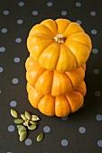 Three baby pumpkins in a pile, pumpkin seeds