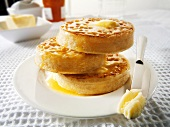 Buttered crumpets on plate (UK)
