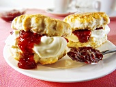 Two scones with jam and clotted cream