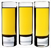 Three glasses of brown rum