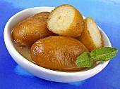 Gulab jamun (Milk balls in sugar syrup, India)