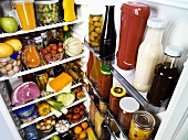 Many different foods in a refrigerator
