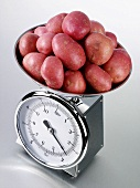 Red potatoes on kitchen scales