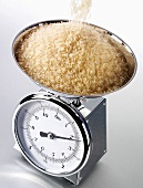Tipping rice onto kitchen scales