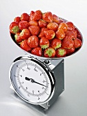 Fresh strawberries on kitchen scales
