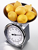 Fresh lemons on kitchen scales