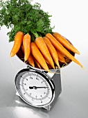 Carrots on kitchen scales