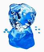 A blue ice cube with reflection