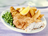 Battered haddock with chips and peas