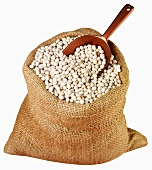 White beans in jute sack with scoop