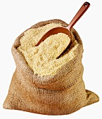 Couscous in jute sack with scoop