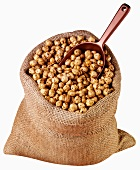Roasted chick-peas in jute sack with scoop