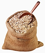 Rolled oats in jute sack with scoop