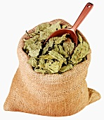 Dried Molohiya leaves in jute sack with scoop