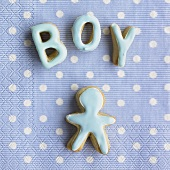 Baked letters spelling 'Boy' and baked figure on a napkin