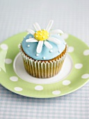 A cupcake with a sugar flower