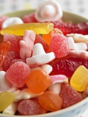 Fruit jelly sweets and marshmallows in a small bowl