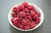 A dish of raspberries