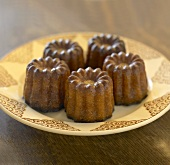 Four cannelés (Small cakes flavoured with vanilla & rum, France)