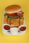 Burger with rocket, chips and dips