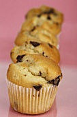 Five chocolate chip muffins in a row
