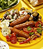 Fried chorizo sausages with vegetables and salad