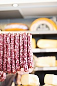 Salami and cheese on a market stall in Belgium