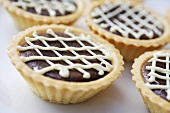 Chocolate tarts with lattice icing