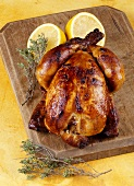 A whole grilled chicken with lemon and thyme
