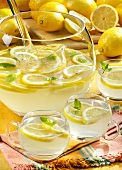Lemonade in punchbowl and glasses