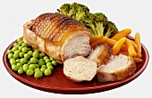 Roast loin of pork with peas, carrots and broccoli