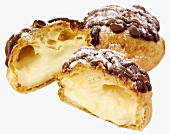 Whole and halved choux pastries filled with vanilla cream