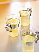 Three glasses of hot toddy (Hot lemon drink, Scotland)
