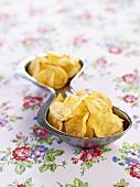 Potato crisps in a metal dish