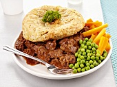 Beef and ale pie with peas and carrots