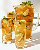 Pimm's Summer Punch in carafe and three glasses