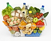 Shopping basket full of mixed groceries