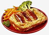 Toad-in-the-hole with vegetables on a plate